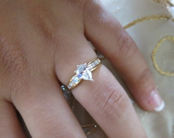 18K Yellow gold Pear shape center and Channel baguettes engagement ring.