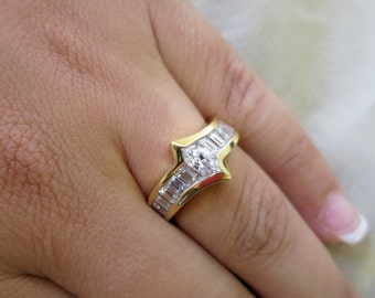 18k Yellow gold Marquise and baguettes engagement ring.
