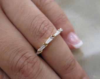 14k Yellow gold diamond tapered baguettes ring.