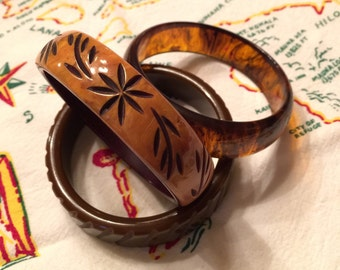 Fantastic set of Three Unique Bangles-Two Carved Bakelite and One Lucite