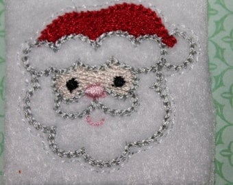 Santa face feltie, Christmas Santa feltie, red hat on white felt, set of four, hair accessories, scrapbooking, and crafts