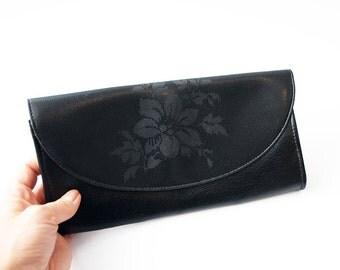 Vintage black evening clutch with floral detail