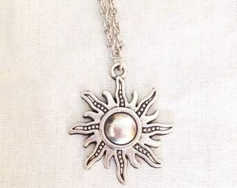 Silver ornate sun pendant necklace
