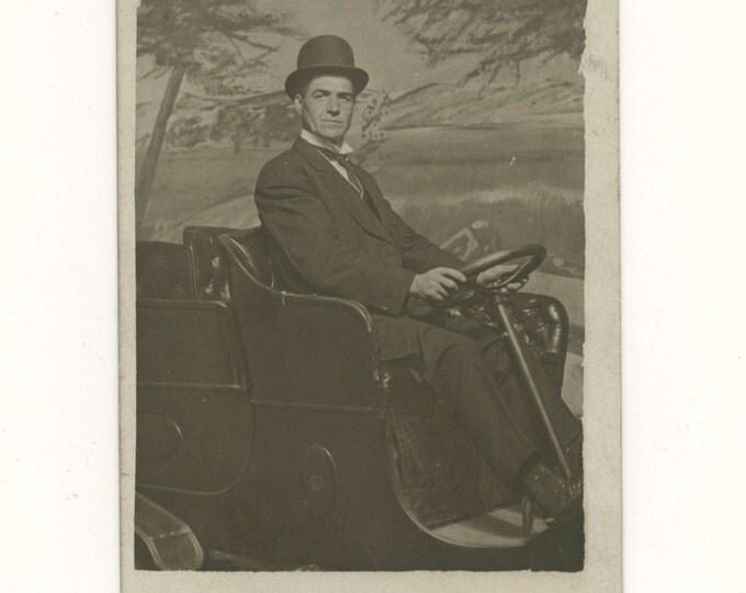 1910s Arcade Photo RPPC: Bowler Hat Gent in Automobile Studio Prop (59408)