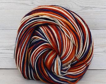 Orion - Hand Dyed Superwash Merino Wool Sport Yarn - Colorway: Broncos