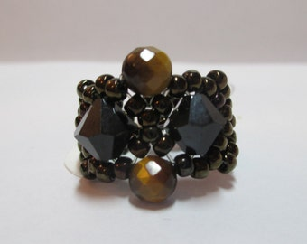 Ring seed beads black bronze with black crystals 8mm with tigers eye round stones on stretchy cord size 7