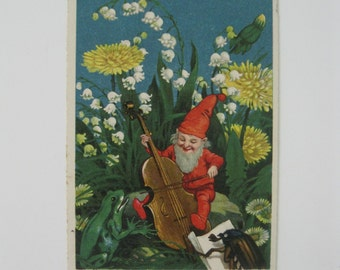 Vintage Post Card - Gnome Playing Cello Amid Flowers - Singing Frog - Bug Reading Music - Series #5297 - Used - 1920s