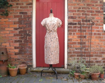 1950s Cocoa Blooms dress / 50s wiggle dress by Norman Linton / vintage floral dress with bow detail