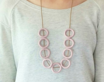 Long pastel pink minimalistic necklace,round clay circles wax cord