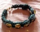 handmade macrame bracelet with green recycled sari silk fabric ribbon. Made in Ireland