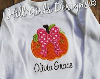 Girl's appliquéd pumpkin with bow ruffled shirt and embroidered name