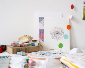 Geometric paper cross-stitch spirograph art. Hand embroidered artwork. Cross stitch on paper 8x10 inches. Wall decor by Rachel Parker.