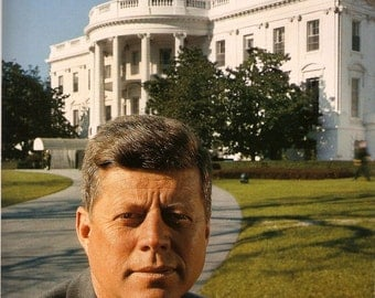 John F. Kennedy taken in front of the White House in Dec of 1961