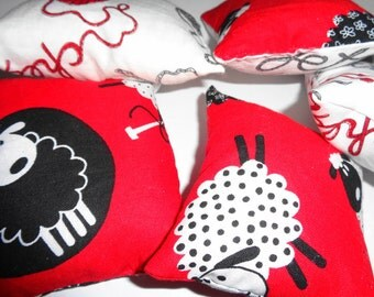 Handmade Knitting themed pin cushions. Either in a plain knitting fabric. Or a fun knitting Sheep fabric. Now reduced.