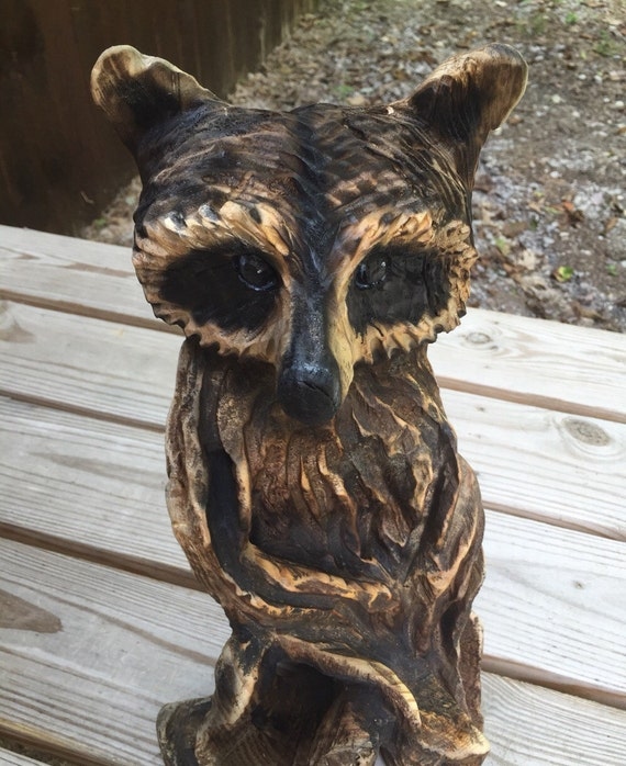 Raccoon chainsaw carving wood hand carved