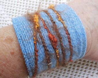 Denim Bracelet or Cuff, 1980's metal button, brown orange slub yarn, stone wash jeans, upcyled vintage jewelry, for 6 1/2 inch wrist