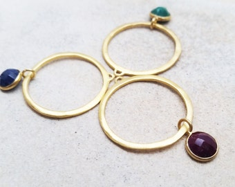 Gold over sterling silver with dangling emerald/ruby/sapphire