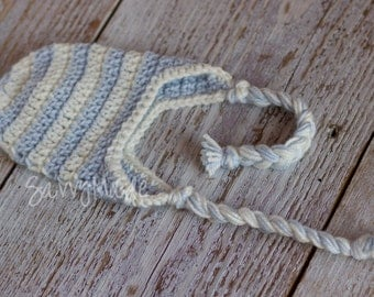 Baby boy crochet winter hat with earflaps. Light blue and cream.