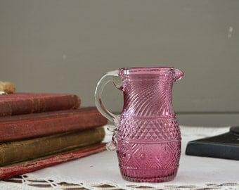 This is a beautiful  piece of cranberry Pilgrim Glass