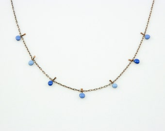 Handmade enameled necklace; 3 shades of tiny blue droplets on a copper chain.