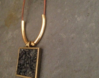 Natural elements, stone, leather, brass power necklace, with Icelandic volcanic beach pebbles to boot!