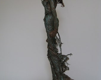 Lady in Green. Sculpture of woman. Autumn Sculpture.