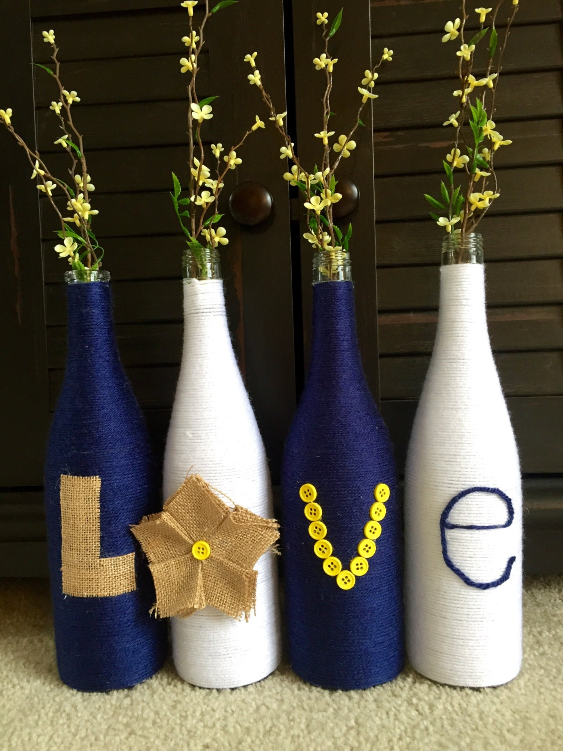 Yarn wrapped bottles wrapped wine bottles burlap with love for How to use wine bottles for decoration