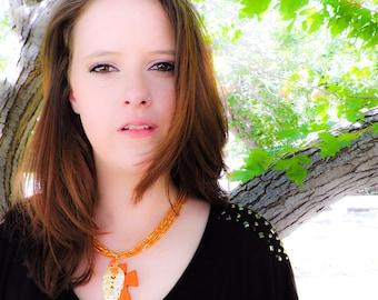 Orange and gold filigree suger skull necklace