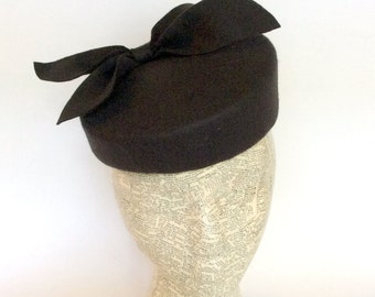 Asymmetrical black felt pillbox fascinator