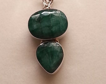 Emerald and sterling silver pendant and chain.