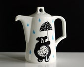 Extra large bear on a bike and raindrops teapot
