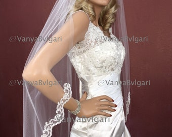 Bridal lace veil in Fingertip length veil with beaded lace starting at waist, classic wedding beaded lace veil with gathered top on a comb
