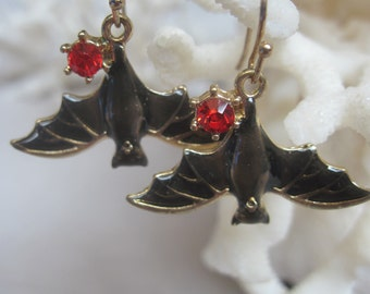 Upside Down Black Bat Earrings with a Red Crystal Accent