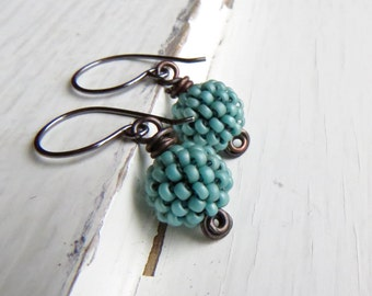 Seafoam green glass handwoven handmade drop earrings with oxidised sterling silver earwires, UK Songbead - narrative jewellery, art jewelry