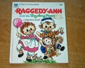 """Vintage Tell A Tale Book, """"Raggedy Ann and the Tagalong Presents A Story About Sounds"""" By Marjory Schwalje, Illustrated by Becky Krehbiel."""