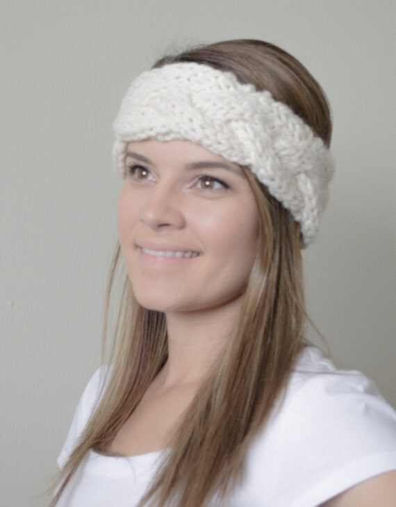 """Braid the three """"legs"""" of the headband till there's about 2 inches left at the ends. Pin the three ends to the beginning of the piece, creating the headband shape. Make sure the ends overlap the beginning of the piece so there's a good amount of space for the size of your buttons."""