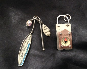Two industrial charm pendants, notebook and cluster drop