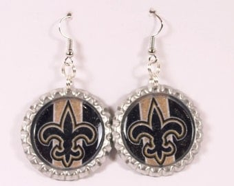 Go Saints! Sparkle and glittered New Orleans Saints inspired bottle cap earrings.