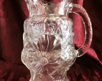 Large clear glass pitcher with flower pattern