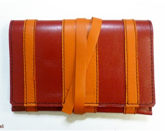 Tobacco leather red and orange, closure strap pouch.