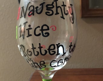 Naughty or Nice painted Christmas wine glass