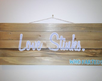Love stinks wood pallet sign