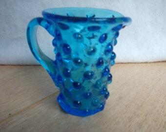 Small blue glass pitcher, hobnail style