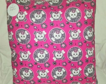 Skulls with bows on pink