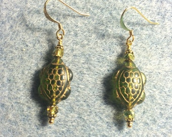 Olive green Czech glass turtle earrings adorned with olive green Chinese crystal beads.