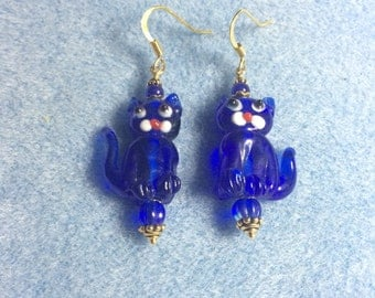 Translucent bright blue lampwork cat bead earrings adorned with blue Czech glass beads.