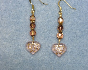 Rose pink Czech glass heart dangle earrings adorned with rose pink Czech glass beads.