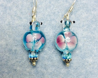 Turquoise and pink lampwork turtle bead dangle earrings adorned with turquoise Czech glass beads.