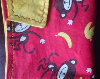 Red and yellow monkey flannel baby blanket