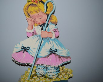 """Thick cardboard rendering of Little Bo Peep crying because she lost her sheep. Great for a child's bedroom or nursery, etc. 17.5"""" x 11"""""""